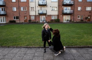 Six-year-old Annalee Corcoran receives ashes from her Aunty Maria outside their home in Meakstown, Dublin, Ireland