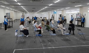 People wait to receive the Moderna vaccine at a newly-opened vaccination centre inside Nagoya Airport on May 27, 2021 in Nagoya, Japan.