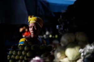 Abidjan, Ivory Coast A woman at a fruit market in Abidjan. The city is home to one-fifth of the population of Ivory Coast, which is adjacent to Burkina Faso, Ghana, Guinea, Liberia and Mali