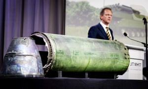 Fred Westerbeke , the chief prosecutor, stands next to a part of the Buk missile fired at MH17.