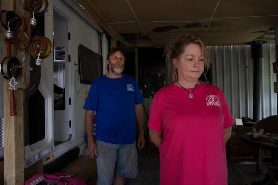Ron and Anna Dunne inside their caravan and shed temporary home on the outskirts of Nelligen