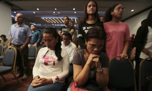 Supporters of opposition presidential candidate Javier Bertucci listen to him in Caracas