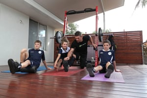 Perth Glory goalkeeper Liam Reddy trains at home with his children Marley, Ziggy and Hendrix.