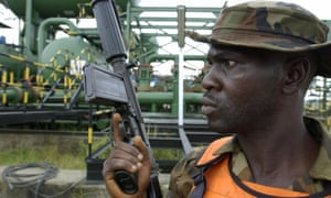 A Nigerian soldier guards an oil facility in the Niger delta.