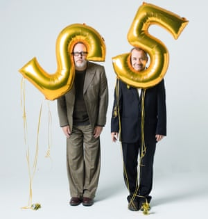 Vic Reeves and Bob Mortimer with large balloons in the shape of the numbers two and five on their heads