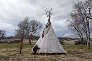Two people taking part in the Fort Laramie treaty ride put up a teepee for an overnight stop in Fort Robinson, Nebraska. The raising of teepees along the ride was unusual. Normally, people slept either in the back of a horse trailer, in their car, in a tent, in a provided shelter like a community centre and on some occasions, in a local motel