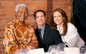 Preston and Travolta with Nelson Mandela at a dinner in Mandela's honour in New York in 2005.