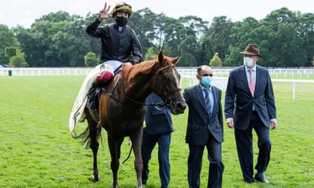 Frankie Dettori celebrates after winning the Gold Cup on Stradivarius, accompanied by trainer John Gosden (right).