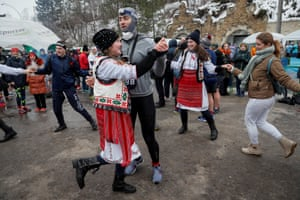 Mileștii Mici, Moldova: People dance with locals in traditional costume before the annual Wine Run