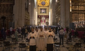 Worshipers attend a funeral Mass at Seville's Cathedral.