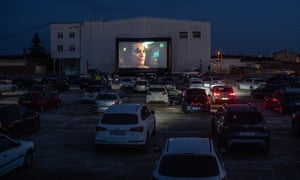 Golmes, Spain: people watch the movie Joker at a temporary drive-in cinema in a nightclub car park near Barcelona