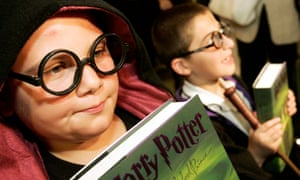 Children dressed as Harry Potter hold Harry Potter books