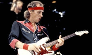 Dire Straits' Mark Knopfler performing live onstage
