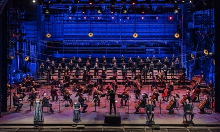 Mark Wigglesworth conducts ENO's orchestra and chorus on stage to perform Mozart Requiem at the London Coliseum.