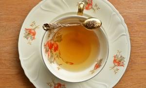 Cup of tea and teaspoon