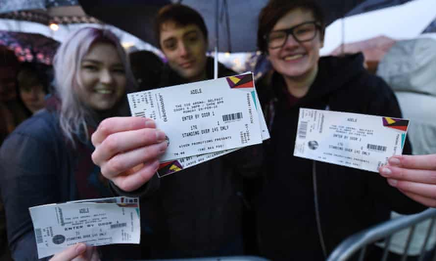 Fans show off their tickets to Adele's February concert in Belfast