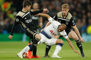 Tottenham's Lucas Moura, centre, duels for the ball with Ajax's Nicolas Tagliafico, left, and Ajax's Frenkie de Jong.