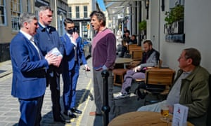 Sir Keir Starmer (left) listening to Rod Humphris (centre), landlord of The Raven pub in Bath, earlier today. Humphris ordered Starmer to leave his pub because of Labour's support for the lockdown.