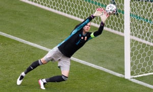 Hungary's Peter Gulacsi looks on as France's Ousmane Dembele hits the post .
