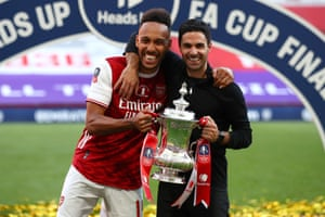 Arsenal captain Pierre-Emerick Aubameyang and manager Mikel Arteta celebrate with the trophy.