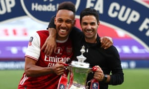 Mikel Arteta (right) said Pierre-Emerick Aubameyang 'is loved by everyone' at Arsenal, adding: 'I think he will stay.'