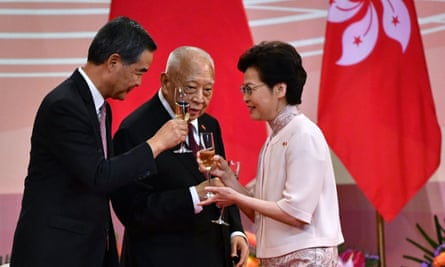 Hong Kong CEO Carrie Lam toasts to his predecessors Tung Chee-hwa (C) and Leung Chun-ying (L).