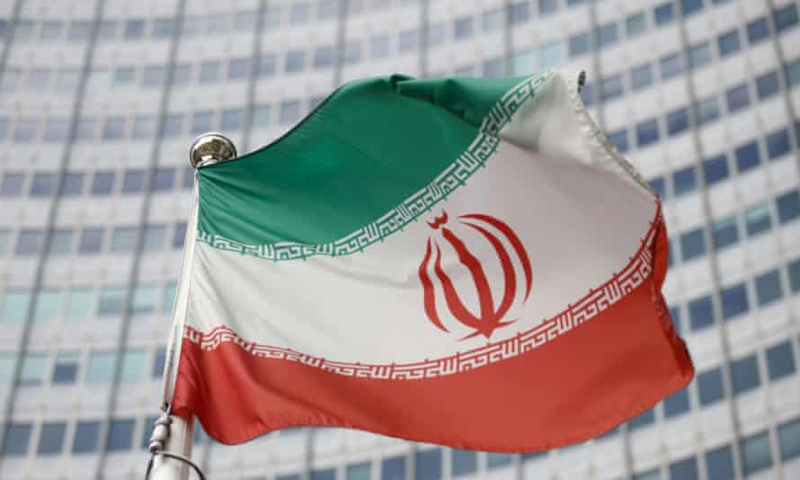 The Iranian flag waves in front of the International Atomic Energy Agency headquarters in Vienna