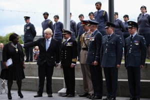 Johnson in 2015 when mayor of London, with Jennette Arnold and members of the British armed forces.)