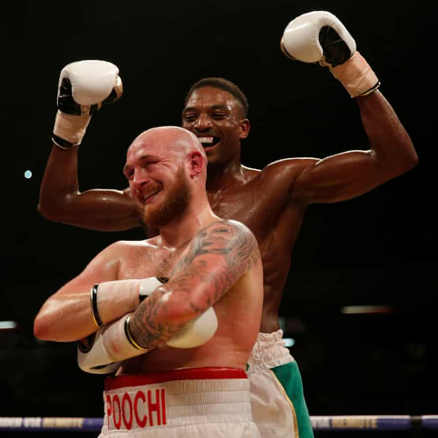 Lewis van Poetsch and Umar Sadiq share a laugh after their fight at the Copper Box Arena in London in 2017.