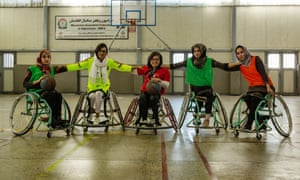 Captain Nilofar Bayat (yellow shirt) with team members during a wheelchair basketball training session in Kabul.