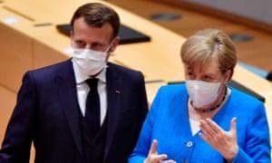 Emmanuel Macron and Angela Merkel in face masks.