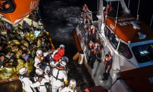 People being rescued off the Libyan coast this November and helped on to a Maltese coastguard boat.