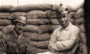British soldiers wearing German helmets.