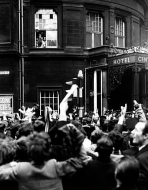 Celtic's Billy McNeill (left) and John Clark show the Scottish Cup to thousands of celebrating fans from a window of the Central Hotel, Glasgow