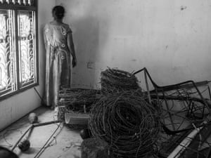 A Tamil woman returns to her home years after the Sri Lankan army confiscated the property and land after the end of the war in 2009.