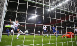 Toby Alderweireld of Tottenham Hotspur clears the ball off the line after a save from Paulo Gazzaniga.