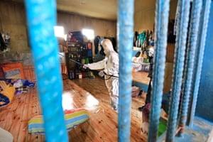Officers spray disinfectant liquid in the prison area in Batam City to prevent the spread of coronavirus.