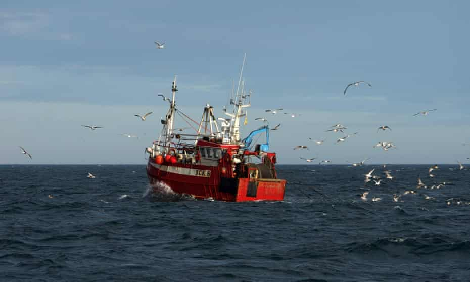 A trawler casts its nets into the North Sea
