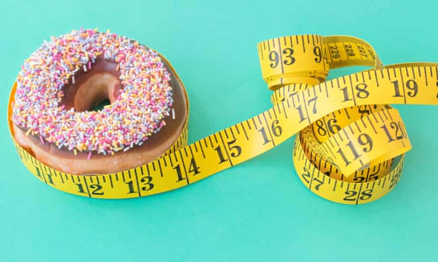 Doughnut and tape measure.