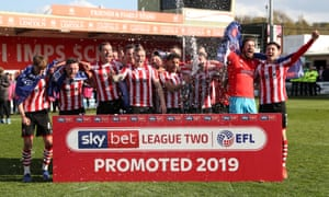 Lincoln players celebrate their promotion.
