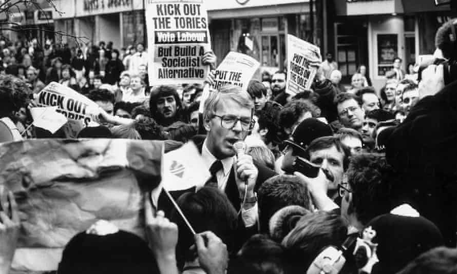 John Major surrounded by leftwing protestors on the campaign trail in Luton
