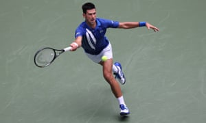 Novak Djokovic stretches for a forehand.