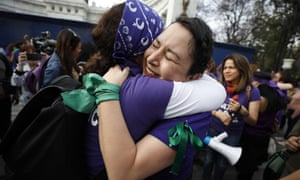 "Participants hug after around 200 women calling for an end to gender violence formed a ""feminist chain"" on the eve of International Women's Day in central Mexico City, Saturday, March 7, 2020."