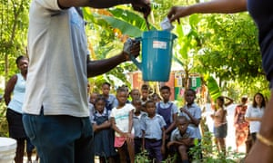 School children near Mirebalais are shown how to mix oral rehydration solution as part of an effort to target any possible cases of cholera in Haiti before they can spread
