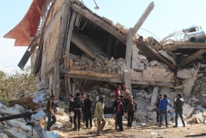 People gather around the rubble of a hospital supported by Doctors Without Borders near Maaret al-Numan, in Syria's northern province of Idlib after the building was hit by suspected Russian air strikes.