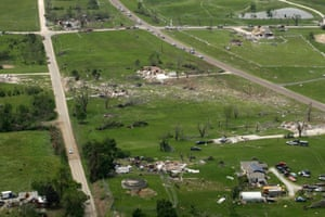 A debris path crosses between damaged homes on 30 May 2019, after a tornado tore through the countryside near Linwood, Kansas