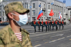 A soldier wearing a face mask in Lenin Square