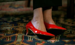 May's red patent pumps as she met with Scotland's First Minister Nicola Sturgeon on July 15.