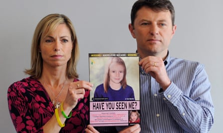 Kate and Gerry McCann hold an age-progressed police image of Madeleine