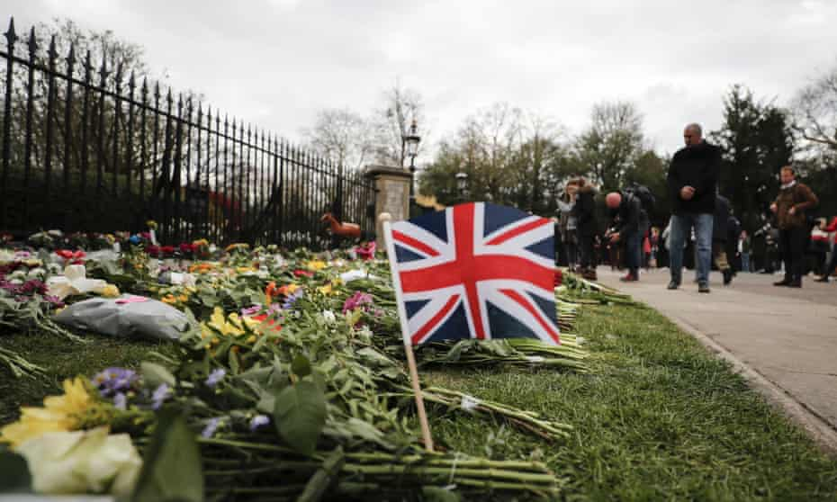 The union flag sits among flowers outside Windsor Castle